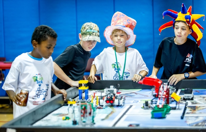 Left to right, Samson Scheie, 12, Brendan Marx, 12 Samuel Snowden, 9, and Joeseph Yoeder, 11, [cq] test out their robot before competing in a First Lego League tournament at DoD's Starbase building near the Air Force Research Laboratory at Wright Patterson Air Force Base in Dayton, Ohio, Jul 22, 2016. The Air Force STEM outreach offices work with the First Lego League, which teaches young students how to build and program robots made of Legos, to not only support STEM education, but also to make young technical minds aware of opportunities to pursue science in the U.S. Air Force.