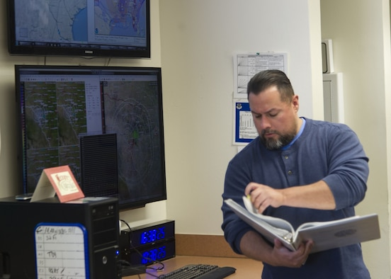 Brian Aragon, 47th Operations Group weather technician, reviews a manual at Laughlin Air Force Base, Texas, Jan. 12, 2018. Crucial to the flying mission, weather provides real-time updates and briefing information not only to the pilots, but also air traffic controllers (ATC) who aid pilots already in the skies and maintainers who work all day, every day on the flightline. (U.S. Air Force photo/Col. Charlie Velino)