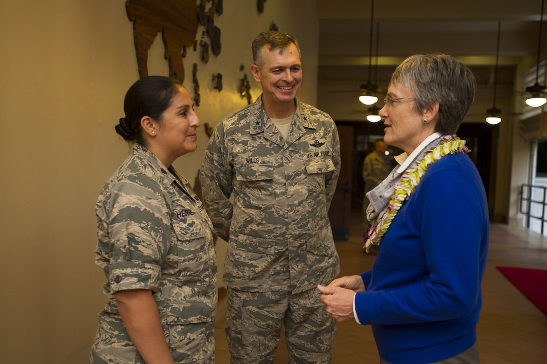 Secretary of the Air Force Heather Wilson speaks with Maj. Monica Herrera, Pacific Air Forces (PACAF) Strategy, Plans and Programs Australia country director (left), and Brig. Gen. Craig Wills, PACAF Strategy, Plans and Programs director (middle), following a theater overview briefing at PACAF headquarters, Joint Base Pearl Harbor-Hickam, Hawaii, Jan. 23, 2018.