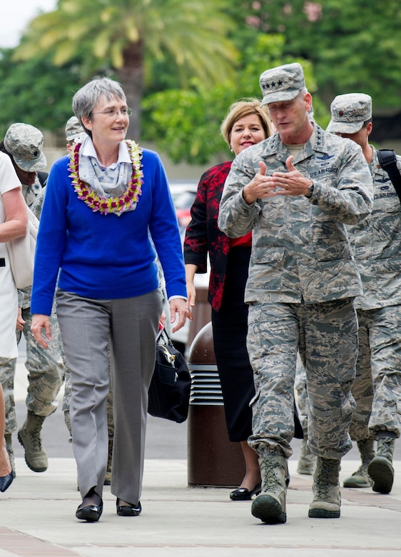 Secretary of the Air Force Heather Wilson and her husband, Jay Hone, walk with Pacific Air Forces (PACAF) Commander Gen. Terrence O'Shaughnessy, upon her arrival to the PACAF headquarters building at Joint Base Pearl Harbor-Hickam, Hawaii, Jan. 23, 2018.