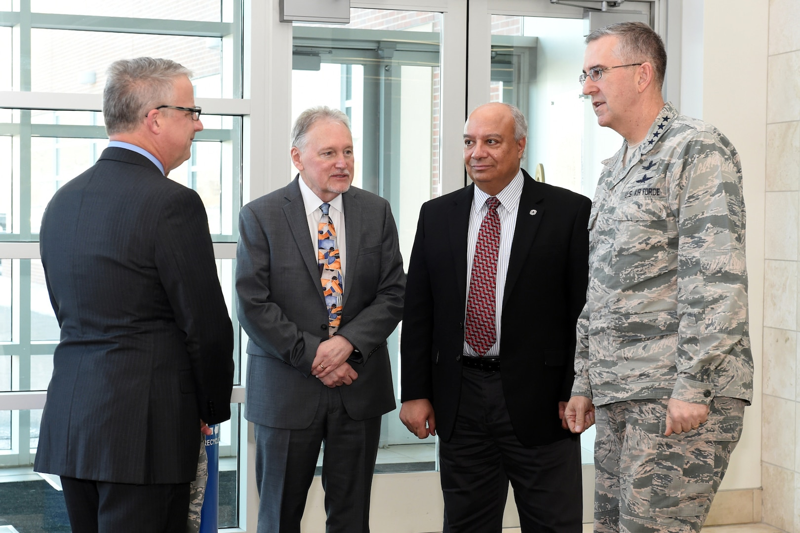 U.S. Air Force Gen. John Hyten (right), commander of U.S. Strategic Command (USSTRATCOM), met with, from left, Scott Snyder, University of Nebraska Omaha (UNO) vice chancellor for research; Louis Pol, UNO dean of the college of business administration, Hesham Ali, UNO dean of the college of information science & technology, prior to attending a brown-bag lunch with USSTRATCOM Strategic Leadership Fellows Program participants at UNO's Mammel Hall, Jan. 24, 2017. The fellows program is designed to develop high-potential civilian leaders in support of USSTRATCOM organizational transformation, broaden mission awareness, and develop leadership skills. USSTRATCOM has global responsibilities assigned through the Unified Command Plan that include strategic deterrence, nuclear operations, space operations, joint electromagnetic spectrum operations, global strike, missile defense, and analysis and targeting.