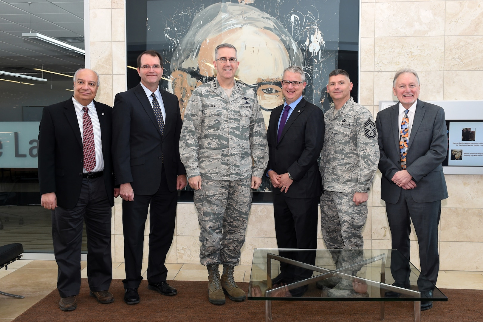 U.S. Air Force Gen. John Hyten (center), commander of U.S. Strategic Command (USSTRATCOM), met with University of Nebraska Omaha (UNO) leadership prior to a brown-bag lunch with USSTRATCOM Strategic Leadership Fellows Program participants at UNO's Mammel Hall, Jan. 24, 2017. From left, Hesham Ali, UNO dean of the college of information science and technology; James M. Taylor Jr., USSTRATCOM Strategic Leadership Fellows Program director; Gen. Hyten; Scott Snyder, UNO vice chancellor for research; U.S. Air Force Chief Master Sgt. Patrick McMahon, senior enlisted leader of USSTRATCOM and Louis Pol, UNO dean of the college of business administration. The fellows program is designed to develop high-potential civilian leaders in support of USSTRATCOM organizational transformation, broaden mission awareness, and develop leadership skills. USSTRATCOM has global responsibilities assigned through the Unified Command Plan that include strategic deterrence, nuclear operations, space operations, joint electromagnetic spectrum operations, global strike, missile defense, and analysis and targeting.