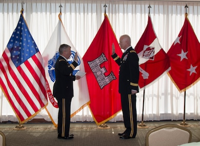 Lt. Gen. Todd T. Semonite (left), Commanding general of the U.S. Army Corps of Engineers administers the Army Officer's Oath of Office to Brig. Gen. Paul E. Owen in a ceremony today in Dallas, Texas.