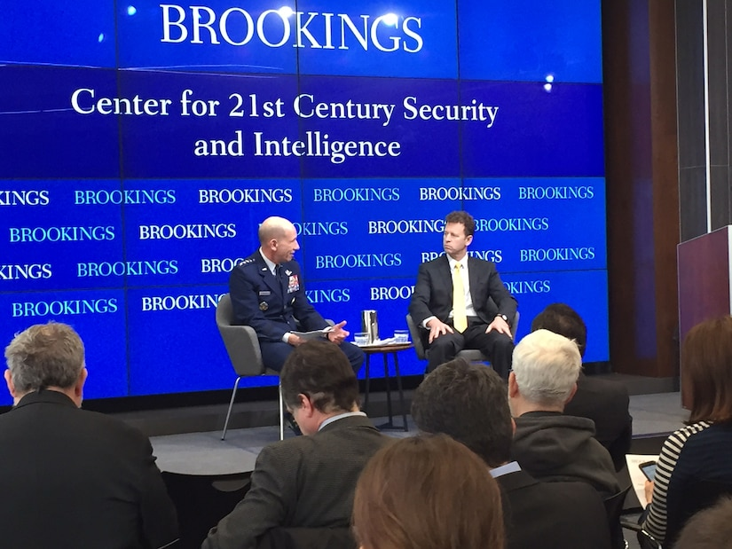 Air Force Gen. James M. Holmes, left, commander of Air Combat Command, speaks with the Brookings Institution's Michael E. O'Hanlon about the challenges of developing doctrine to fight the multidomain battle.