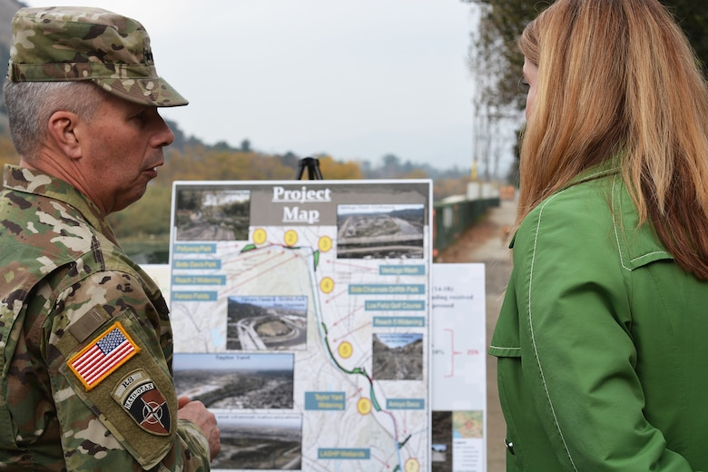 Lt. Gen. Todd Semonite, commanding general of U.S. Army Corps of Engineers, left, and Carol Armstrong, executive officer to the Los Angeles Deputy Mayor of City Services, right discuss the LA River Ecosystem Restoration project during a Jan. 19 site visit.