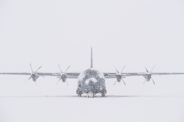 A C-130J Super Hercules sits on the flightline during a snow storm, Jan. 22, 2018, at Yokota Air Base, Japan.