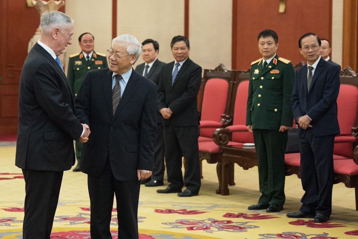 Defense Secretary James N. Mattis shakes hands with the Communist Party General Secretary.