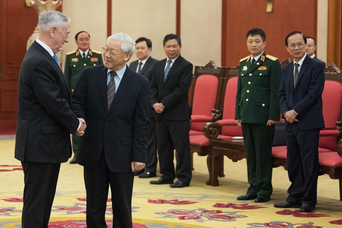 Defense Secretary James N. Mattis shakes hands with the Communist Party General Secretary.