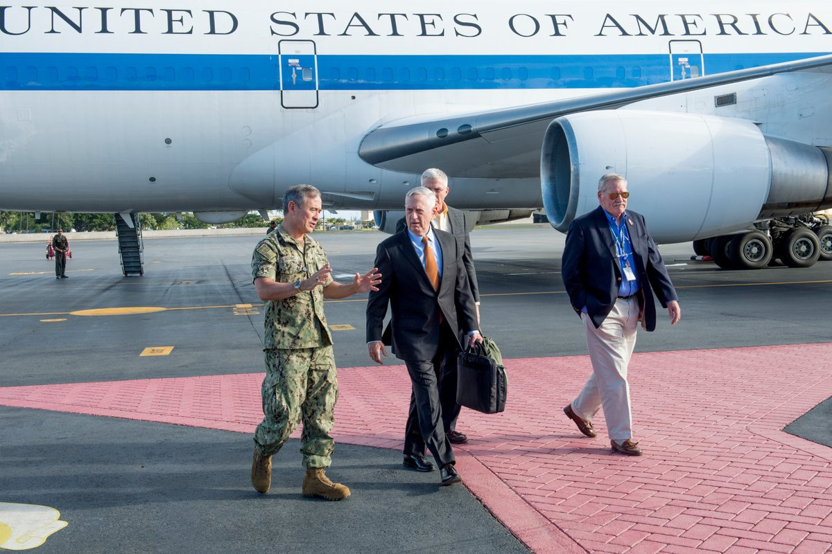 Defense Secretary James N. Mattis walks along the tarmac after arriving in Hawaii.