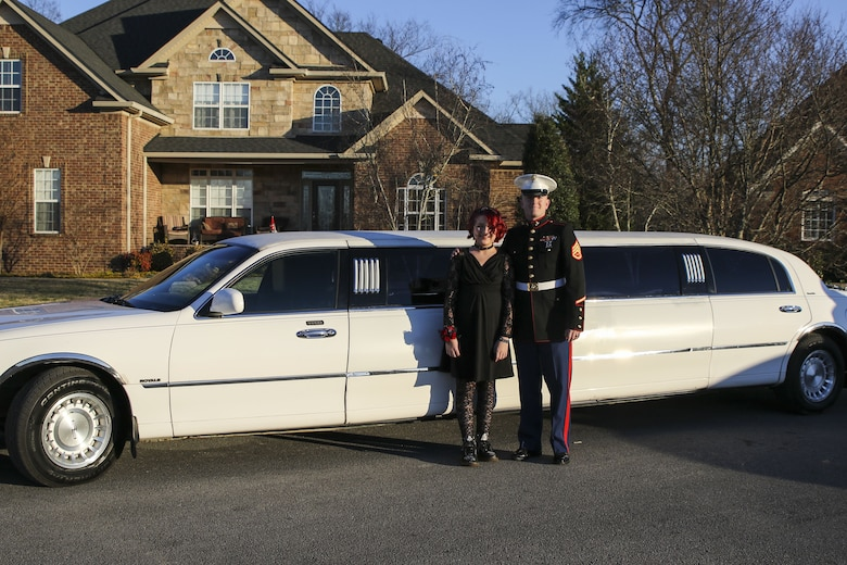 U.S. Marine Staff Sgt. Brian D. Raney, the station commander for Recruiting Substation Murfreesboro, stands with Raven Campbell outside of their limo for a father-daughter dance at St. Mark's United Methodist Church, Murfreesboro, Tennessee, on Jan. 20, 2017. Raven did not have a father to go with but dreamed of attending the dance with a Marine. Raney stepped in to make her dreams come true. Raney is a recruiter currently stationed with Recruiting Station Nashville, 6th Marine Corps District, Eastern Recruiting Region, Marine Corps Recruiting Command. (U.S. Marines photo by Sgt. Mandaline Hatch)