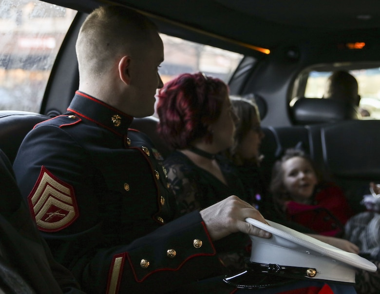 U.S. Marine Staff Sgt. Brian D. Raney, the station commander for Recruiting Substation Murfreesboro, rides in a limo with Girl Scouts to a father-daughter dance at St. Mark's United Methodist Church, Murfreesboro, Tennessee, on Jan. 20, 2017. Raney stepped in as the father figure for one of the Girl Scouts, Raven Campbell. Raney is a recruiter currently stationed with Recruiting Station Nashville, 6th Marine Corps District, Eastern Recruiting Region, Marine Corps Recruiting Command. (U.S. Marines photo by Sgt. Mandaline Hatch)