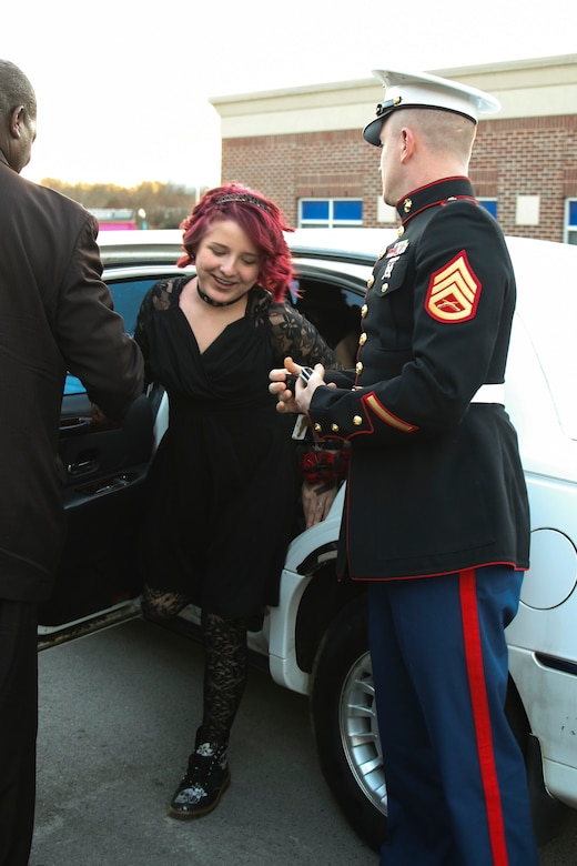 U.S. Marine Staff Sgt. Brian D. Raney waits for Raven Campbell to exit the limo at St. Mark's United Methodist Church, Murfreesboro, Tennessee, on Jan. 20, 2018. Raney and the community came together to make the father-daughter dance a special night for Raven. Raney is a recruiter currently stationed with Recruiting Station Nashville, 6th Marine Corps District, Eastern Recruiting Region, Marine Corps Recruiting Command. (U.S. Marines photo by Sgt. Mandaline Hatch)