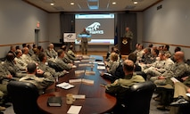 The 55th Wing leadership team looks on as Col. Michael Manion, 55th Wing commander, officially unveils the War