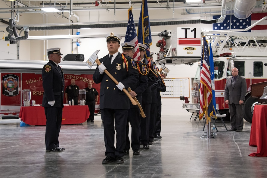 Photo of the firefighters during a ceremony to open Hill's new flight line fire station.