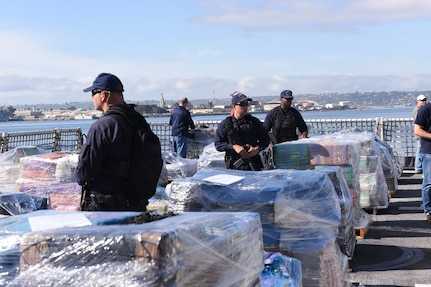 Coast Guard Cutter Stratton boarding team members guard 47,000 pounds of seized cocaine