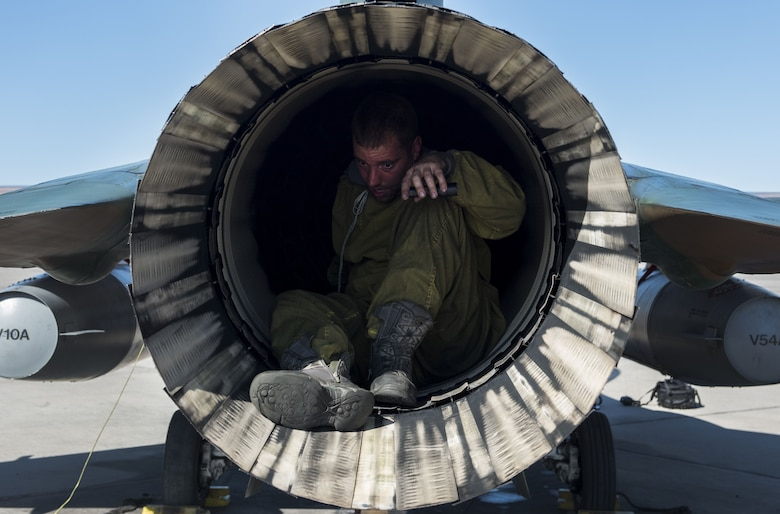 Staff Sgt. Michael Dalrymple, 57th Aircraft Maintenance Squadron crew chief, checks the exhaust of an F-16 Fighting Falcon on the flight line at Nellis Air Force Base, Nev., Aug. 25, 2017. Dalrymple is assigned to the Aggressors who are responsible for providing the opposing threat during training exercises at Nellis AFB. (U.S. Air Force photo by Senior Airman Kevin Tanenbaum)