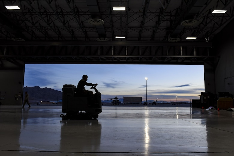 Airman 1st Class Charles Curran, 823rd Maintenance Squadron electrical environmental apprentice, uses a floor scrubber at Nellis Air Force Base, Nev., Jan. 5, 2018. Floor scrubbers remove dust, oil and grease to maintain a safe and clean work environment. (U.S. Air Force photo by Airman 1st Class Andrew D. Sarver)