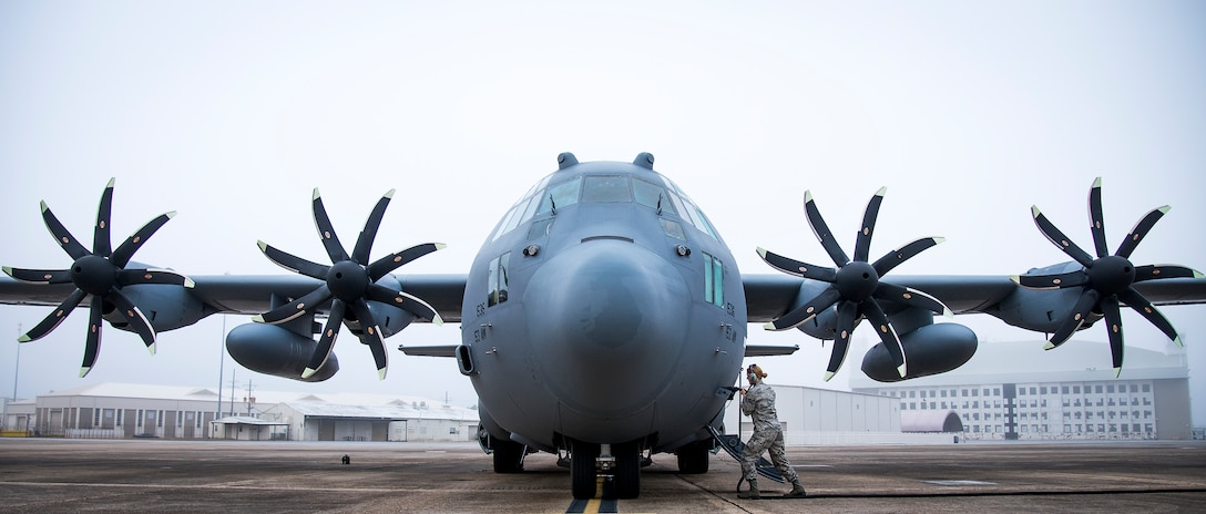 A 153rd Airlift Wing maintainer plugs in a generator cable into her C-130H Hercules after arriving at Eglin Air Force Base, Fla., Jan. 11, 2018. The Air Force's first fully upgraded C-130H is here for test and evaluation on its new modified propeller system and engines. (U.S. Air Force photo by Samuel King Jr.)