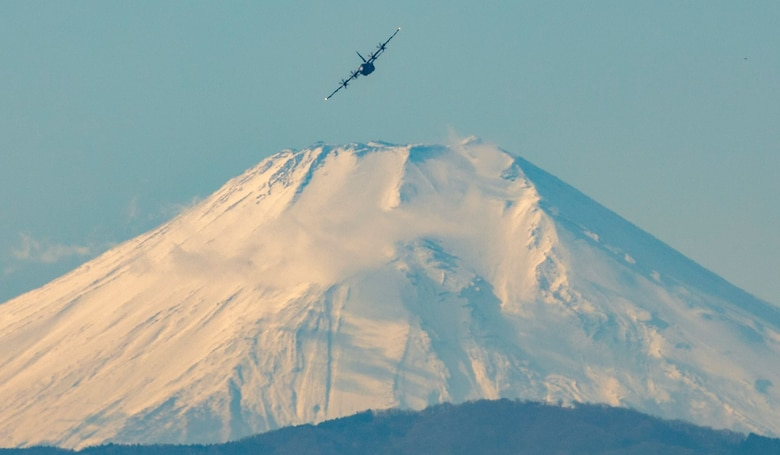 A C-130J Super Hercules assigned to the 36th Airlift Squadron flies near Mt. Fuji, Japan, during a routine sortie, Jan. 12, 2018 at Yokota Air Base, Japan. The 36th AS regularly conducts training missions to remain proficient in the necessary skills to support any contingency. (U.S. Air Force photo by Yasuo Osakabe)