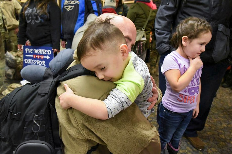 Tech. Sgt. Matthew Clark, assigned to the 119th Civil Engineer Squadron, hugs his son after 193 days apart upon completion of a six-month deployment to Southwest Asia, as he arrives at the North Dakota Air National Guard Base, Fargo, N.D., Jan. 15, 2018. (U.S. Air National Guard photo by Senior Master Sgt. David H. Lipp)