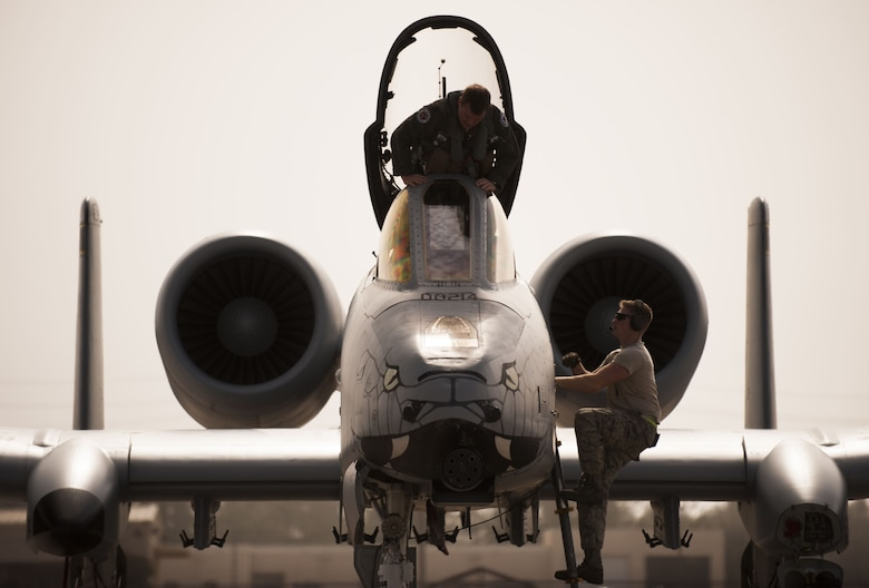 "A pilot from the 163rd Fighter Squadron, left, and Staff Sgt. Michael Gresley, 122nd Aircraft Maintenance crew chief, 122nd Fighter Wing, Fort Wayne, Ind., climb to the cockpit of an A-10C ""Warthog"" aircraft during Operation Guardian Blitz, Jan. 23, 2018, at MacDill Air Force Base, Fla. Both crew chief and pilot perform inspections prior to takeoff to ensure success of the mission. The 122nd Fighter Wing and the 163rd Fighter Squadron constantly train to ensure our members are always prepared to defend the nation. (U.S. Air National Guard photo by Staff Sgt. William Hopper)"