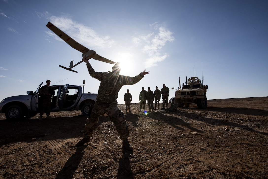 Tech Sgt. Matthew Coutts, assigned to the 332d Expeditionary Security Forces Squadron, launches a Raven B Digital Data Link drone during a demonstration Jan. 24, 2018 in Southwest Asia. After takeoff, the Raven B uses battery power to patrol the air for 60-90 minutes at a time.  (U.S. Air Force photo by Staff Sgt. Joshua Kleinholz)
