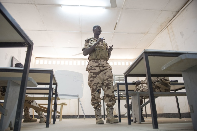 Chadian Air Force Adjudant Chef Issackha Babour, security anti-terrorism student, instructs a class on security procedures during held by the 818th Mobility Support Advisory Squadron as part of a mobile training team event at Adjikossei Air Base, N'Djamena, Chad, January 15, 2018.