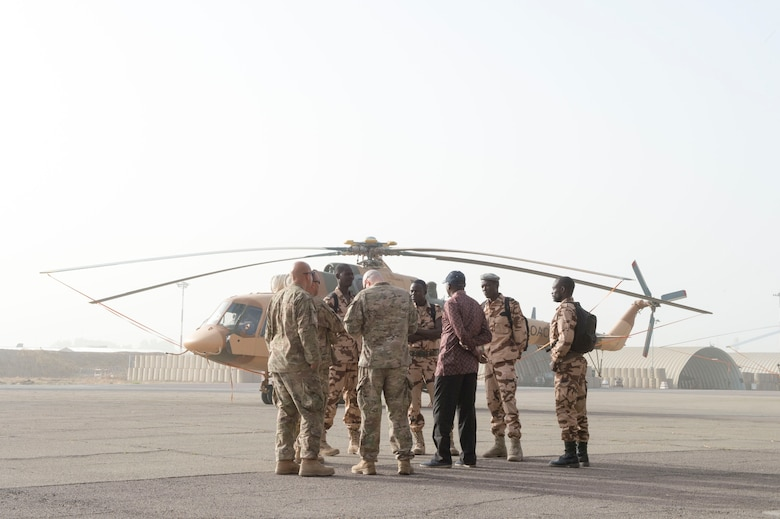 Members of the U.S. Air Force 818th Mobility Support Advisory Squadron go over airfield security procedures with members of the Chadian Air Force Airmen during a mobile training team event at Adjikossei Air Base, N'Djamena, Chad, January 16, 2018.