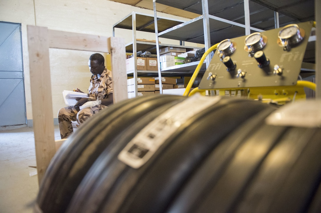 A Chadian Air Force Airman takes accountability of equipment during a training mobility training team event with the 818th Mission Support Advisory Squadron at Adjikossei Air Base, N'Djamena, Chad, January 18, 2018.