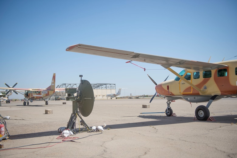 Two C-208 aircraft are parked on the flightline at Adjikossei Air Base, Chad, January 18, 2018.