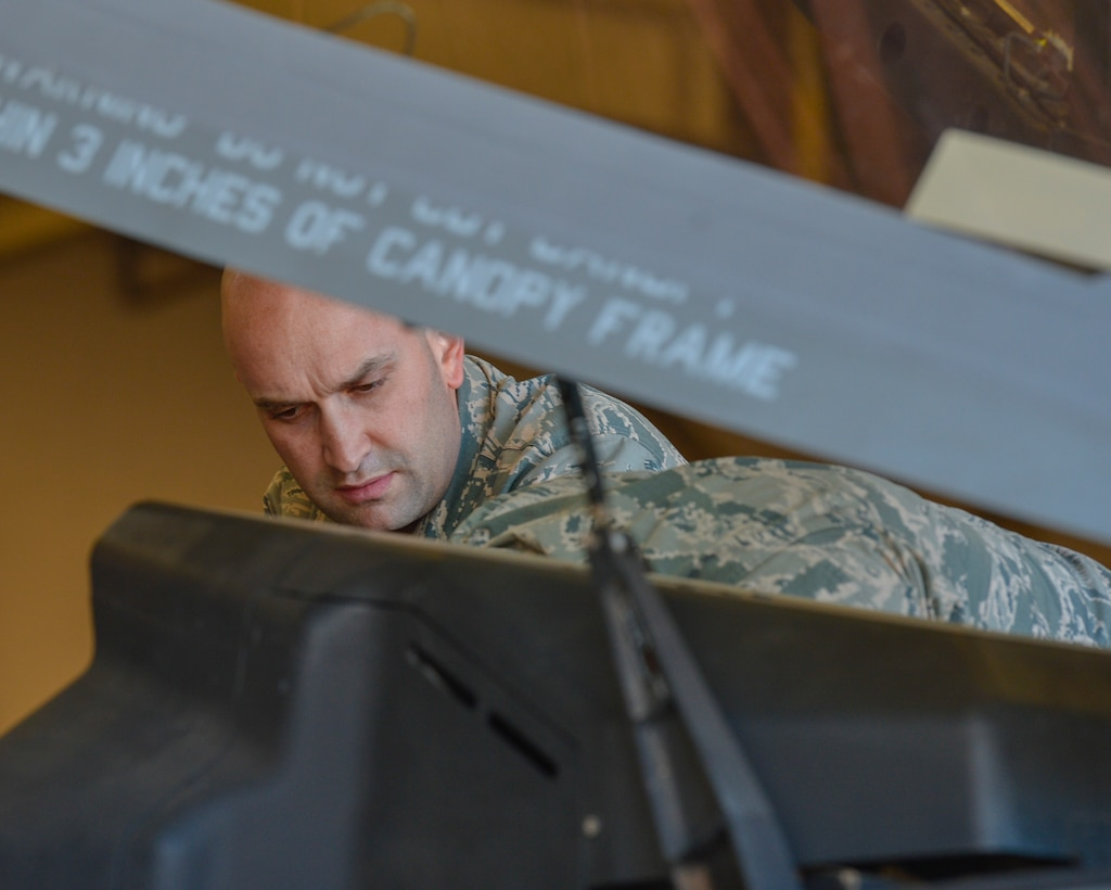Tech. Sgt. Joseph Scalise, 56th Component Maintenance Squadron egress systems technician, performs safety checks on the canopy of an F-35A Lightning II before the removal of an ejection seat at Luke Air Force Base, Ariz., Jan. 11, 2018. All F-35s and partner nation aircraft at Luke are scheduled to receive new ejection seat modifications in the near future. (U.S. Air Force photo/Airman 1st Class Caleb Worpel)