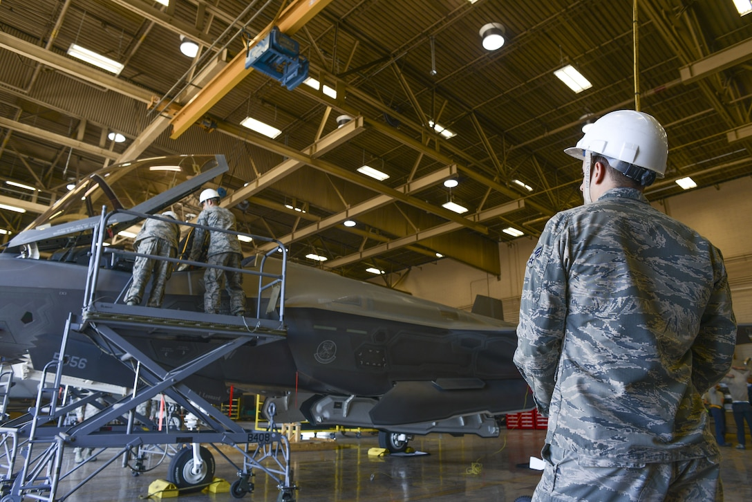Senior Airman Bradley Isom, 56th Component Maintenance Squadron egress systems technician, controls an overhead crane used to remove an ejection seat from an F-35A Lightning II at Luke Air Force Base, Ariz., Jan. 11, 2018. In May 2017, three modifications were implemented to the F-35 ejection system to remove the 136 pound weight limit restriction. (U.S. Air Force photo/Airman 1st Class Caleb Worpel)