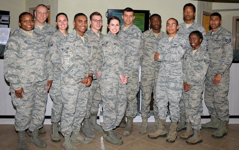 U.S. Air Force Airmen with the 6th Force Support Squadron pause for a photo at the ID card office on MacDill Air Force Base, Fla., Jan. 18, 2018.