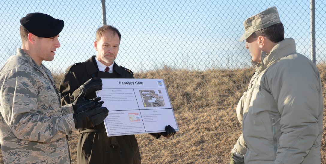Capt. Michael Olson, with the 72nd Security Forces Squadron and Brad Beam, with the 72nd Civil Engineering Directorate, brief Air Force Sustainment Center Commander Lt. Gen. Lee K. Levy II on the requirements, communication plan and future needs of the newly-opened Pegasus Gate located on South Air Depot Blvd. They also provided an overview of traffic flow changes due to gate construction