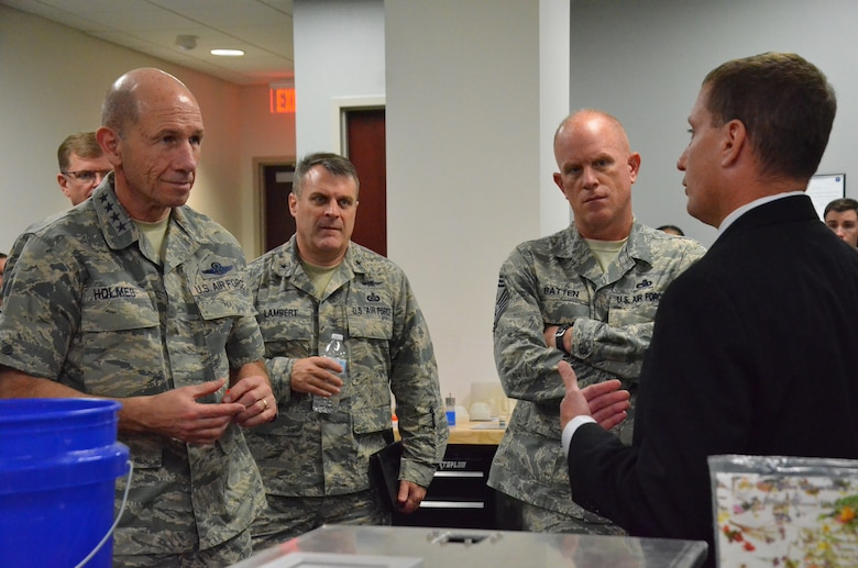 Kevin Jack (right), a radio frequency engineer at the Air Force Technical Applications Center, Patrick AFB, Fla., explains rapid prototyping of deployable antenna systems to (l. to r.) Gen. Mike Holmes, commander of Air Combat Command, Brig. Gen. Peter Lambert, ACC director of intelligence, and Chief Master Sgt. Frank Batten, ACC command chief, during their visit to the Department of Defense's sole nuclear treaty monitoring center Jan. 24, 2018.  (U.S. Air Force photo by Susan A. Romano)