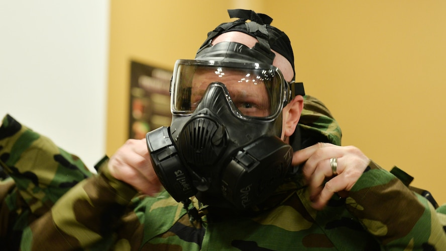 Staff Sgt. Chris Cutler with the 55th Medical Group, puts on his oxygen mask before going through a training exercise with various working stations inside the Martin Bomber building on Offutt AFB, Neb., Jan. 18.