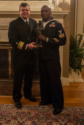 Commander, Navy Reserve Forces Command, Rear Adm. Thomas Luscher, left, presents Hospital Corpsman 1st Class Cedrick Jenkins, assigned to Commander, 4th Marine Division, Marine Forces Reserve, with a Lone Sailor Award  following his selection as Fiscal Year 2017 Navy Reserve Full Time Support Shore Sailor of Year (SOY). Jenkins will go on to compete for the title of 2017 Vice Chief of Naval Operations (Naval Shore Activities) SOY. (U.S. Navy photo by Mass Communication Specialist 2nd Class Sean Rinner)