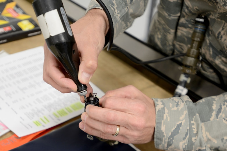 A 20th Fighter Wing Airman engraves a serial number at Shaw Air Force Base, S.C., Jan. 22, 2018.