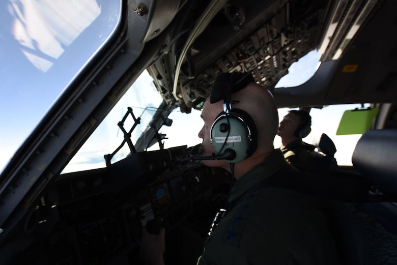Gen. Carlton D. Everhart II, Air Mobility Command commander, pilots a C-17 Globemaster III near Joint Base Lewis-McChord, Wash., Jan. 25, 2018. Everhart flew the aircraft during his visit to JBLM to see what Team McChord is made of during an exercise. (U.S. Air Force photo by Senior Airman Tryphena Mayhugh)