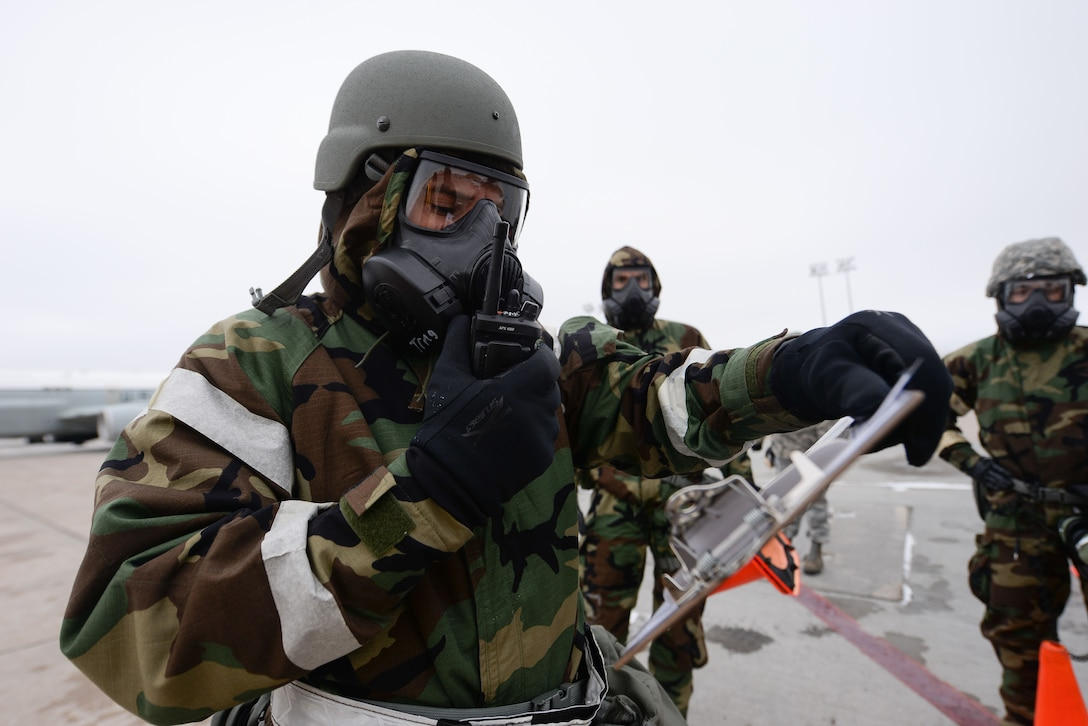 Members of the 55th Wing begin a post attack reconnaissance sweep of the flight line during an Operational Readiness Exercise (ORE) at Offutt Air Force Base, Neb., Jan. 23.