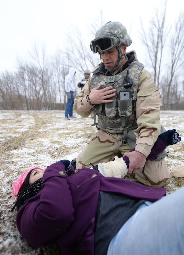 Tech. Sgt. Johann Gonzalez, 55th Security Forces Squadron training instructor, performs self-aid buddy care on an individual during an Operational Readiness Exercise at Offutt Air Force Base, Neb., Jan. 23.