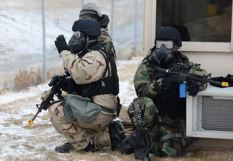 Members of the 55th Security Forces Squadron secure the perimeter during a simulated attack during an Operational Readiness Exercise at Offutt Air Force Base, Neb., Jan. 23,