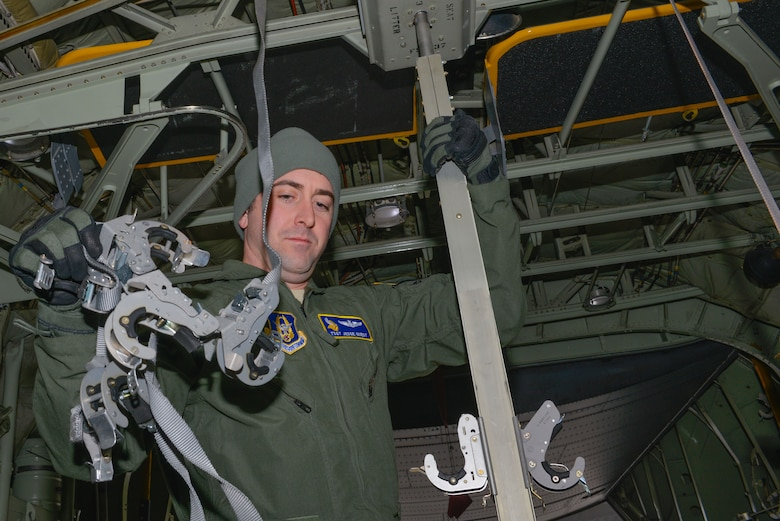 Tech. Sgt. Jesse Guest, a reserve aeromedical technician with the 934th Aeromedical Evacuation Squadron, configures the inside of a C-130 to accept patient litters prior to a trainer mission at the Minneapolis-St. Paul Air Reserve Station, Minn., on Jan. 8, 2018. Guest is also an emergency medical technician for the St. Paul fire department. (U.S. Air Force photo by Master Sgt. Eric Amidon)