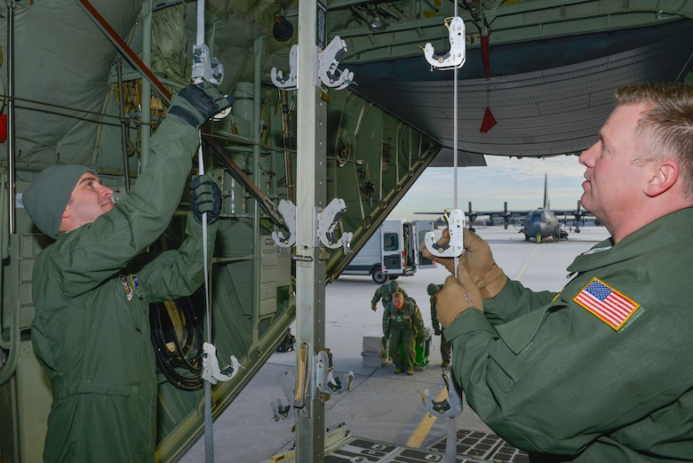 Tech. Sgt. Jesse Guest and Master Sgt. Zak Johnson reserve aeromedical technicians with the 934th Aeromedical Evacuation Squadron, prepare the inside of a C-130 to hold patient litters for an aeromedical evacuation training mission at the Minneapolis-St. Paul Air Reserve Station, Minn., on Jan. 8, 2018. The trainer missions help members of the AES maintain their currency and hone their skills in preparation for any future deployments or contingencies. (U.S. Air Force photo by Master Sgt. Eric Amidon)