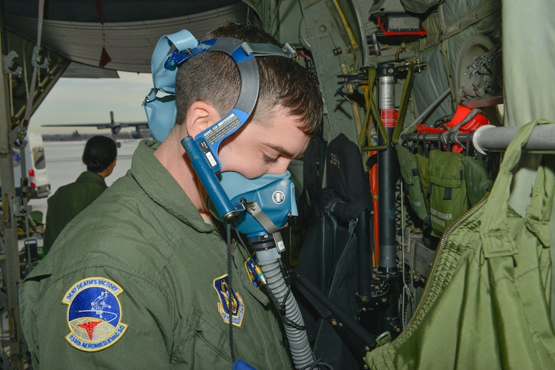 Tech. Sgt. Jesse Guest, a reserve aeromedical technician with the 934th Aeromedical Evacuation Squadron, tests his self-contained breathing equipment prior to participating in a trainer mission  at the Minneapolis-St. Paul Air Reserve Station, Minn., on Jan. 8, 2018. The trainer missions provide training in aeromedical evacuation procedures and combat medical support. (U.S. Air Force photo by Master Sgt. Eric Amidon)