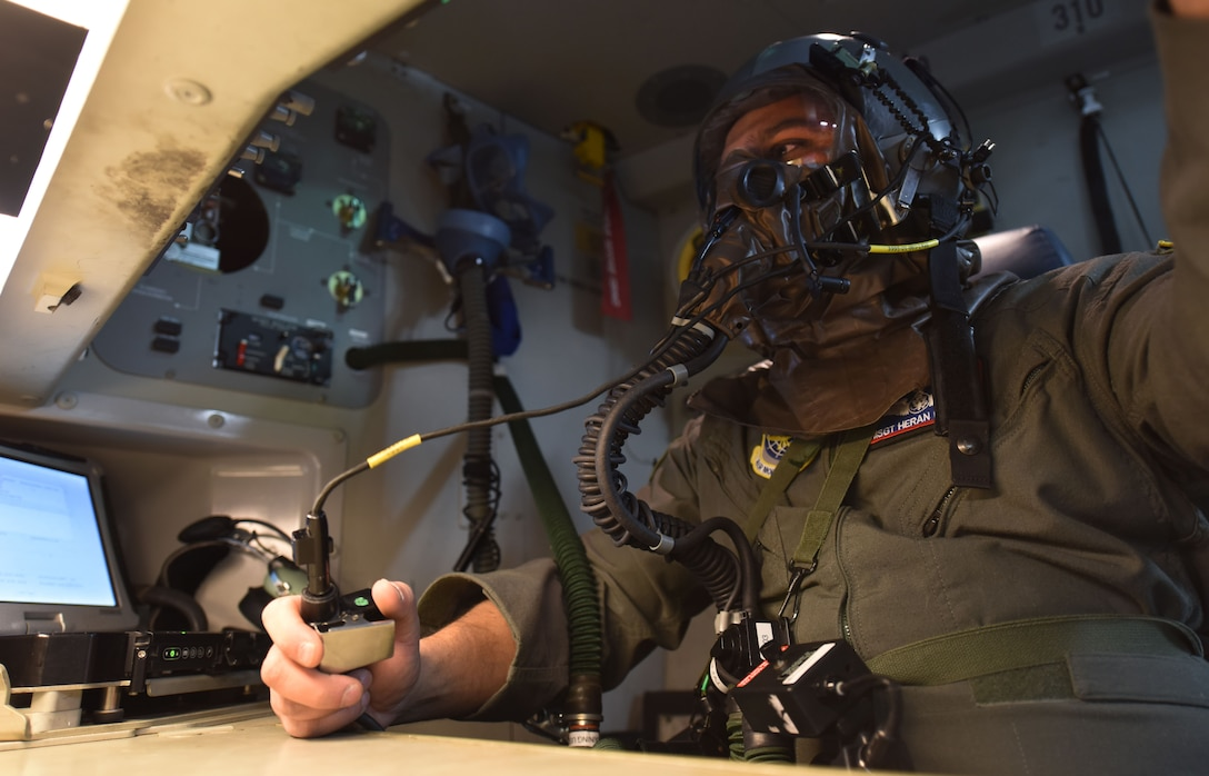 Master Sgt. Heran Pandya, 62nd Operations Support Squadron crew chief, checks his communication with the pilots of a C-17 Globemaster III during Exercise Winterhook at Joint Base Lewis-McChord, Wash., Jan. 25, 2018. Team McChord participated in the exercise from Jan. 22 to 26 to practice their ability to deploy and operate during a chemical, biological, radiological or nuclear threat. (U.S. Air Force photo by Senior Airman Tryphena Mayhugh)