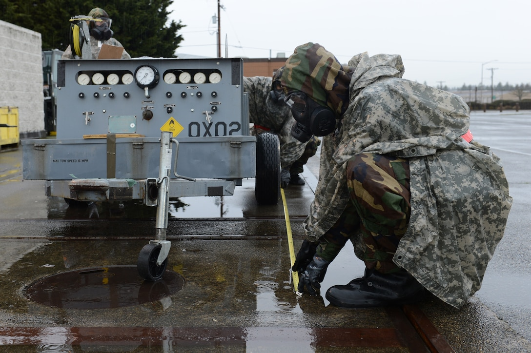 Airman 1st Class Conner Adams and Airman 1st Class Andrew Amezquita, 62nd Aerial Port Squadron air transportation, measure cargo for upload during Exercise Winterhook, Jan 23, 2018, at the McChord Field flightline, Joint Base Lewis-McChord, Wash. Cargo is checked for correct documentation, weights, and dimensions before being loaded onto an aircraft. (U.S. Air Force photo by Airman 1st Class Sara Hoerichs)