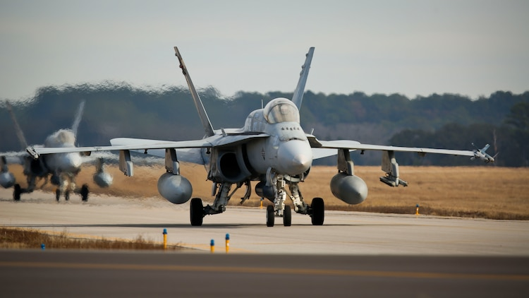 F/A-18C Hornets taxi down the flight line aboard Marine Corps Air Station Beaufort, Jan. 22.