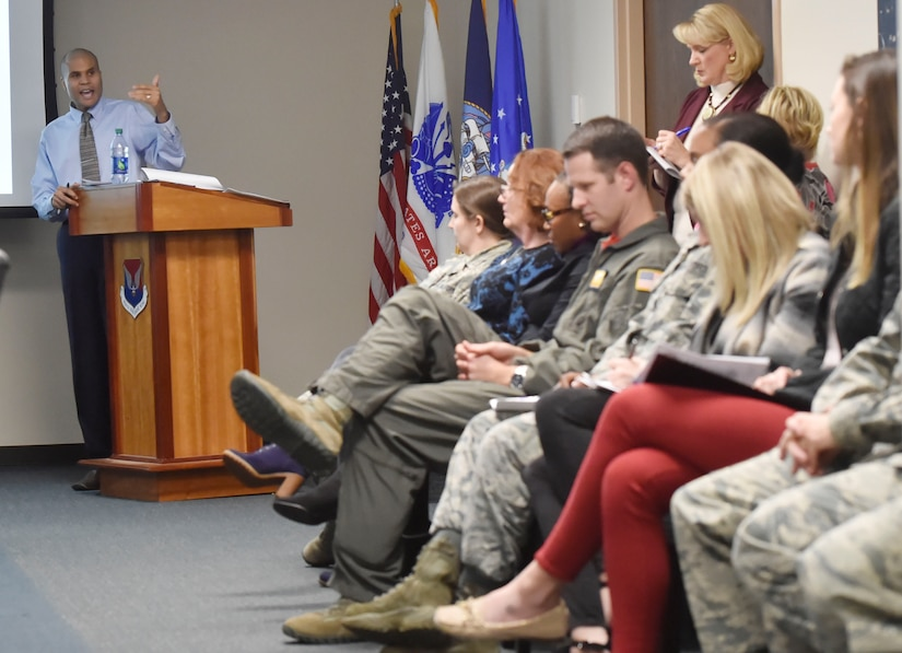 Toby Housey, left, 628th Air Base Wing equal opportunity office director, shares quarterly data gathered by the Community Action Team here Jan. 26, 2018. The Community Action Team uses these meetings as an opportunity to inform base leadership on the needs and trends of military members and their families stationed at Joint Base Charleston.