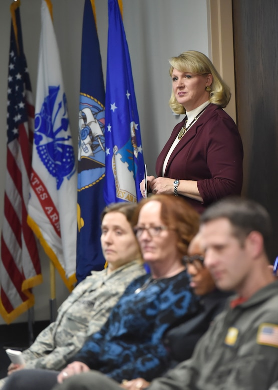Michelle McMeekin, Community Support Coordinator at Joint Base Charleston, S.C., shares quarterly data gathered by the Community Action Team to joint base leadership here Jan. 26, 2018. The Community Action Team uses these meetings as an opportunity to inform base leadership on the needs and trends of military members and their families stationed at Joint Base Charleston.